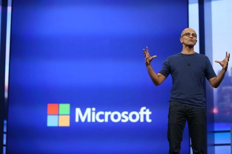 "Microsoft CEO Satya Nadella gestures during his keynote address at the company's ""build"" conference in San Francisco"