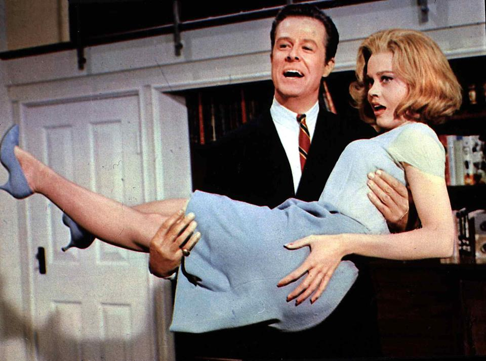 <p>Fonda, as Eileen Tyler, is scooped up by Robert Culp in <em>Sunday in New York</em> in 1963.</p>