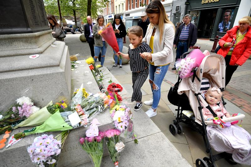 Lexi Willoughby, who was present at the Manchester Bombing, lays flowers in Saint Anne's Square (Getty Images)