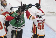 Calgary Flames' Erik Gustafsson (56) and Dallas Stars' Corey Perry (10) rough it up during second period NHL Western Conference Stanley Cup playoff hockey action in Edmonton, Alberta, Tuesday, Aug. 18, 2020. (Jason Franson/The Canadian Press via AP)