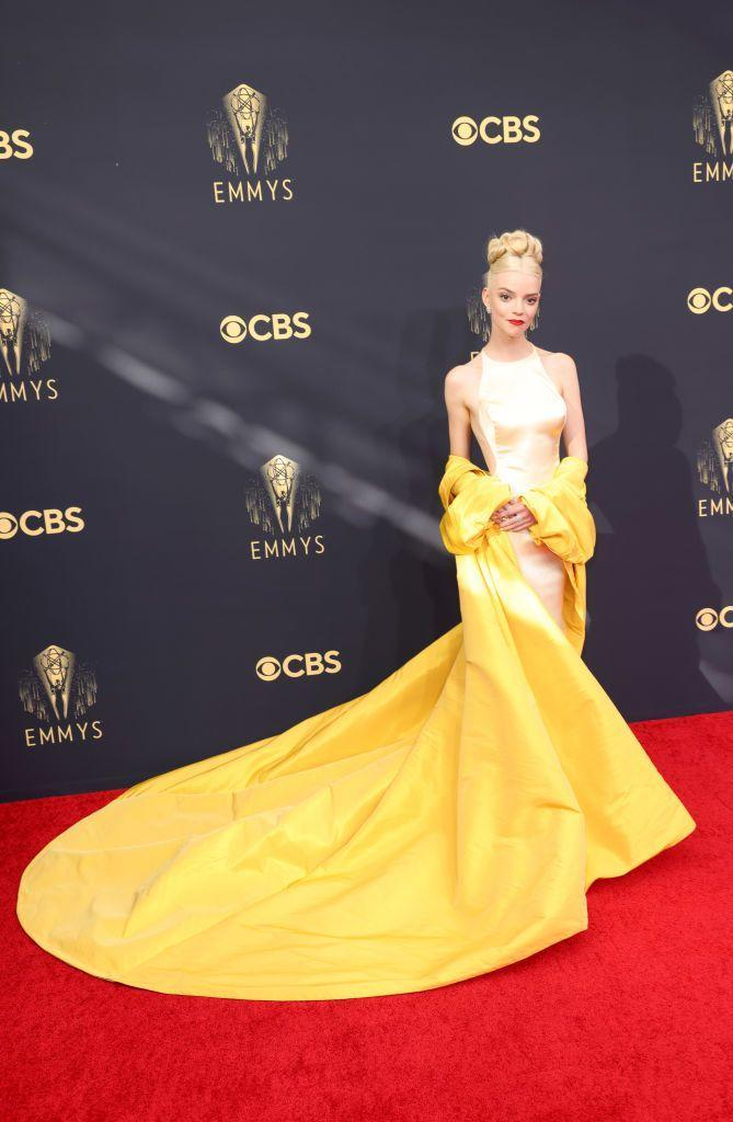 <p>Anya Taylor Joy and her stylist Law Roach are becoming a force to be reckoned with. The actress is one of the most exciting people to watch on the red carpet right now, and she did not disappoint for the 2021 Emmys, where she chose a beautiful cream satin gown by Dior Haute Couture with a dramatic yellow train, paired with sparkling Tiffany & Co jewellery.</p>