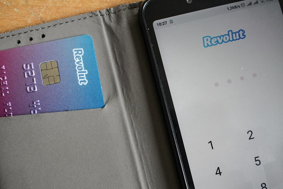 Revolut card next to of Android Revolut mobile app launched on the smartphone is seen in Gdansk, Poland on 9 July 2019  Revolut reached over 400.000 users in Poland this year. The number of Polish clients increased by 100% in 9 months period. Revolut Ltd is a UK financial technology company that offers banking services  (Photo by Michal Fludra/NurPhoto via Getty Images)