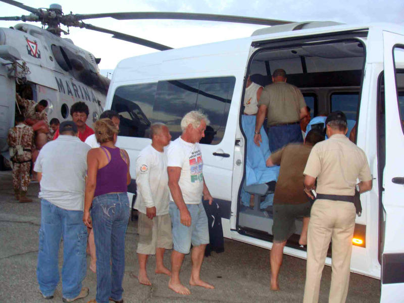 In this image released by the Mexican Navy on Monday July 4, 2011, survivors of a capsized boat are taken away in a vehicle after being rescued by the Navy  in the town of San Felipe, Mexico Monday July 4, 2011. A U.S. tourist died after a fishing boat capsized in an unexpected storm in the Gulf of California off the Baja California peninsula and of the 44 people on the boat, seven U.S. tourists remain missing along with one Mexican crew member, the Mexican Navy said. (AP Photo/SEMAR)