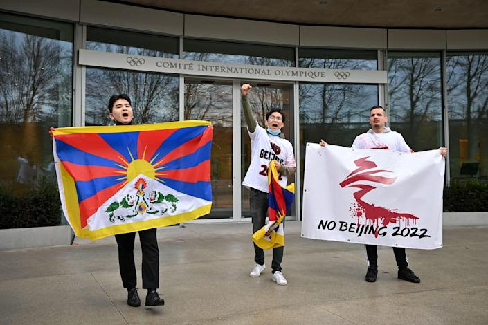 Activists of the International Tibet Network holds Tibet's flags in front of the IOC headquarters during a protest against Beijing 2022 Winter Olympics on February 3, 2021 in Lausanne. A coalition of campaign groups issued an open letter calling on world leaders to boycott the Beijing 2022 Winter Olympics over China's rights record.AFP via Getty Images