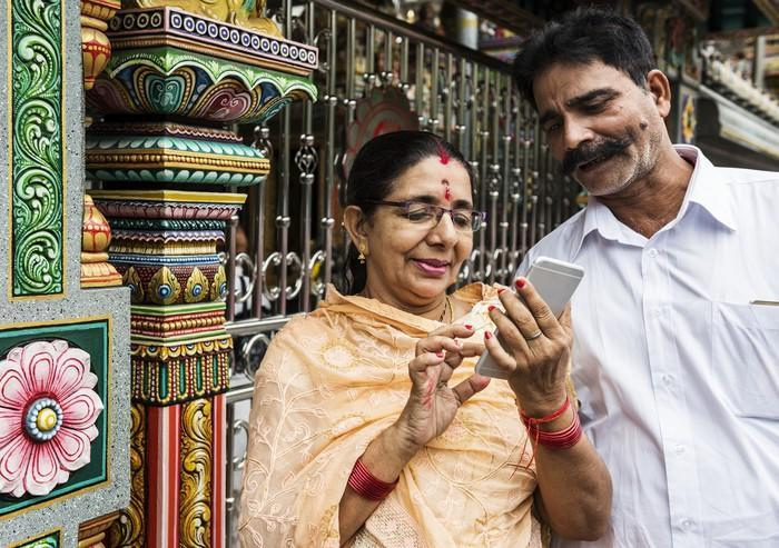 Indian couple using a smartphone