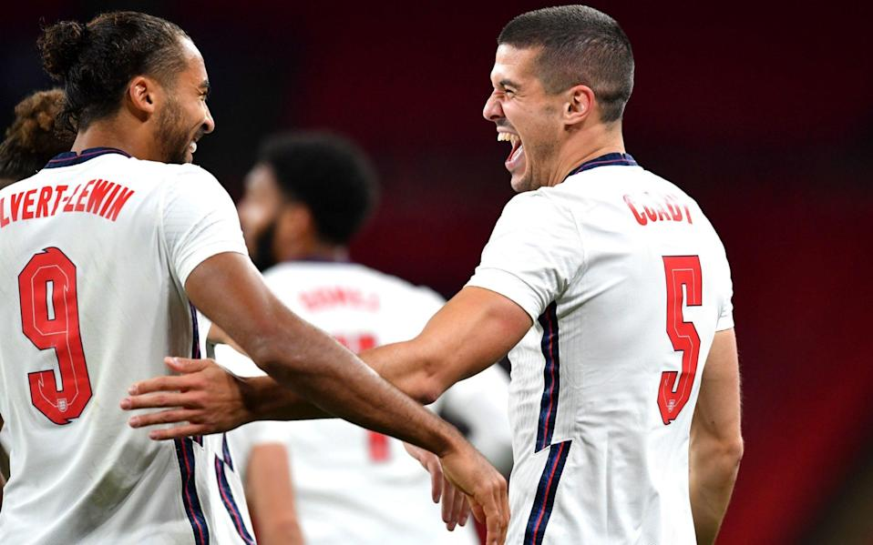England's Conor Coady (right) celebrates scoring his side's second goal of the game with Dominic Calvert-Lewin - PA