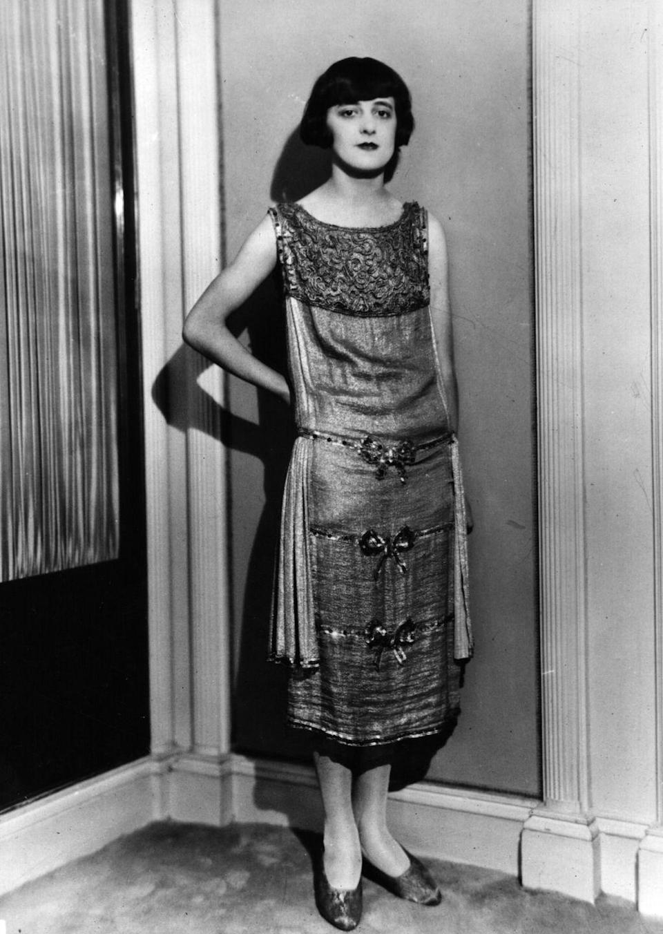 <p>There was an extreme excess of wealth during the '20s, and that meant opulent details. Fringe, paneling, and embroidery were all typical of a glamorous dress during this time. </p>