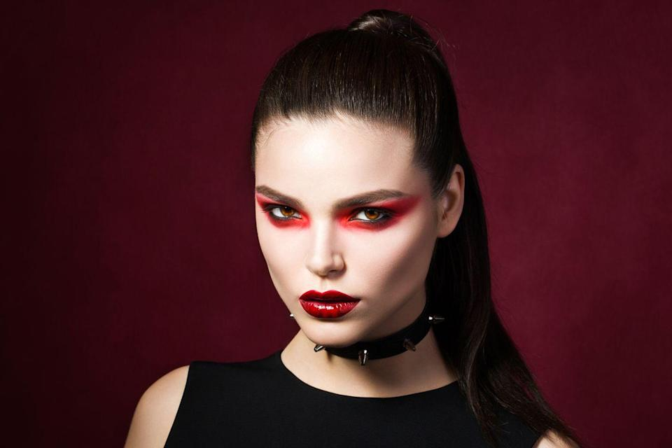 """<p>Instead of the usual zombie-like look, opt for striking red shadow that dramatically sweeps off the lid in a winged shape. It perfectly complements an all-black ensemble topped with a studded choker. </p><p><a class=""""link rapid-noclick-resp"""" href=""""https://www.amazon.com/Eyeshadow-Professional-Pigmented-Waterproof-Blendable/dp/B08ZMVHBKF?tag=syn-yahoo-20&ascsubtag=%5Bartid%7C10072.g.37080875%5Bsrc%7Cyahoo-us"""" rel=""""nofollow noopener"""" target=""""_blank"""" data-ylk=""""slk:SHOP RED SHADOW"""">SHOP RED SHADOW</a></p>"""