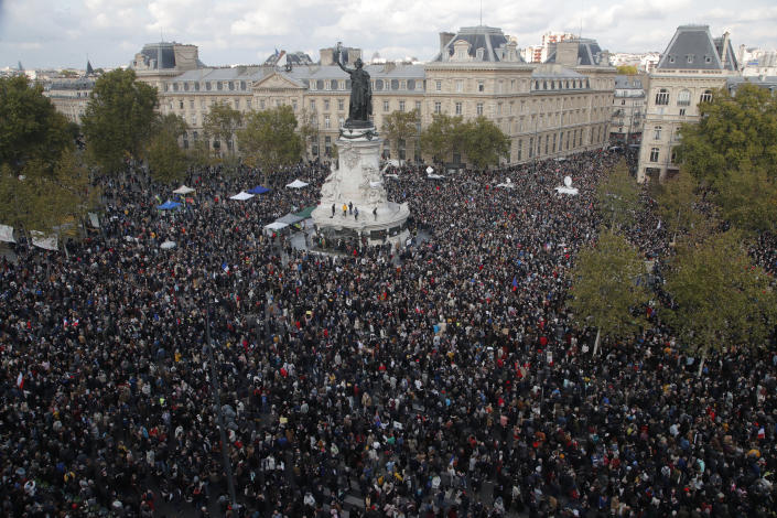 Hundreds of people gather on Republique square during a demonstration Sunday Oct. 18, 2020 in Paris. Demonstrations around France have been called in support of freedom of speech and to pay tribute to a French history teacher who was beheaded near Paris after discussing caricatures of Islam's Prophet Muhammad with his class. Samuel Paty was beheaded on Friday by a 18-year-old Moscow-born Chechen refugee who was shot dead by police. (AP Photo/Michel Euler)