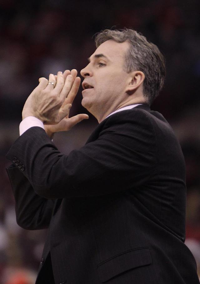 """FILE - In this Nov. 20, 2013 file photo, American University's head coach Mike Brennan instructs his team against Ohio State during the first half of an NCAA college basketball game in Columbus, Ohio. From Princeton to American by way of Georgetown with a guard named """"Peewee,"""" Brennan has the Eagles unbeaten in the Patriot League in his first season at the school. (AP Photo/Jay LaPrete, File)"""