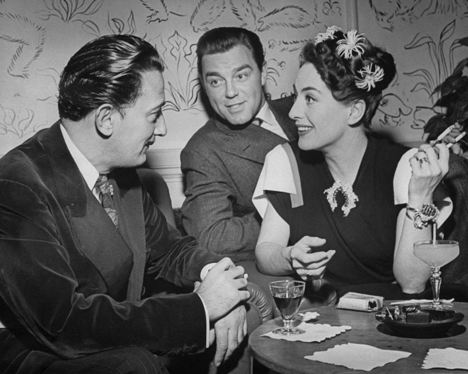 <p>Actress Joan Crawford and her husband, actor Phillip Terry, chat with artist Salvador Dali at the Del Monte resort in Monterey, California.</p><p>Other celebrity visitors this year: Shirley Temple.</p>