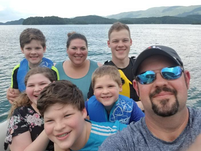 Dr. Daniel Lewis poses for a selfie with his wife Jessica and five children during a recent family outing. Lewis spent five weeks away from his family after he became infected with coronavirus in March.