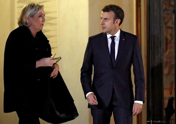 FILE PHOTO: French President Emmanuel Macron accompanies Marine Le Pen, head of France's far-right National Front (FN) following a meeting at the Elysee Palace in Paris
