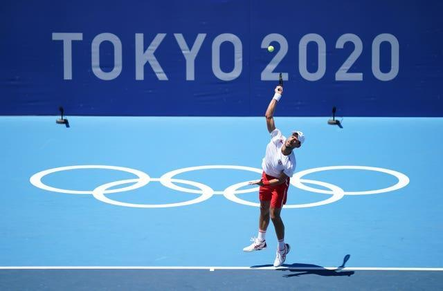Novak Djokovic, seeking to become the first man in history to win a Golden Slam of all four grand slam titles and Olympic singles gold in the same year, trains in Tokyo (Mike Egerton/PA)