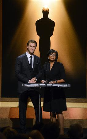Actor Chris Hemsworth (L) and Academy of Motion Picture Arts and Sciences President Cheryl Boone Isaacs announce the nominees for the 86th Academy Awards in Beverly Hills, California January 16, 2014. REUTERS/Phil McCarten