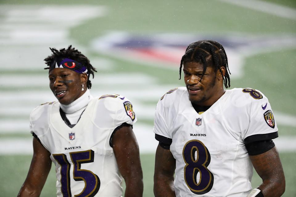 Lamar Jackson #8 and Marquise Brown #15 of the Baltimore Ravens