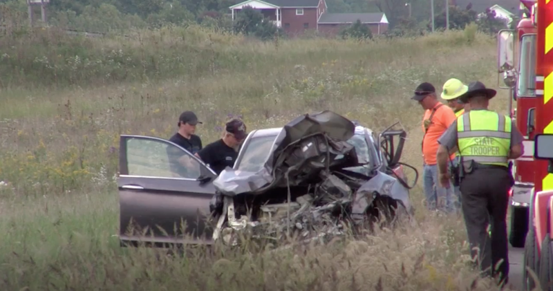 Police say a man thrown from the car during the crash died hours earlier.