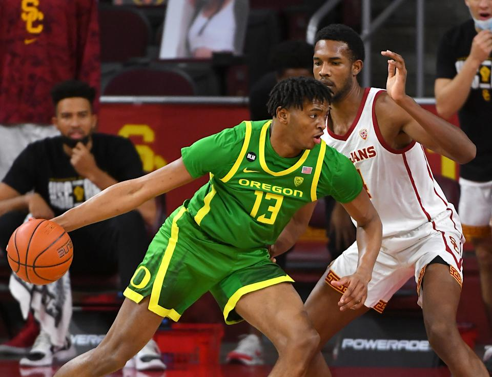 Feb 22, 2021; Los Angeles, California, USA; Oregon Ducks forward Chandler Lawson (13) is defended by USC Trojans forward Evan Mobley (4) as he drives to the basket in the first half of the game at Galen Center. Mandatory Credit: Jayne Kamin-Oncea-USA TODAY Sports