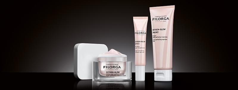 A small bottle and two tubes of Filorga products.