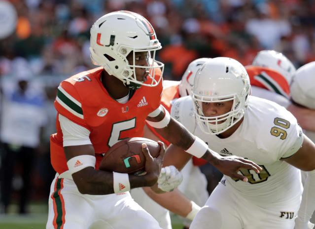 Miami quarterback N'Kosi Perry (5) runs as FIU defensive lineman Noah Curtis (90) defends during the first half of an NCAA college football game, Saturday, Sept. 22, 2018, in Miami Gardens, Fla. (AP Photo/Lynne Sladky)