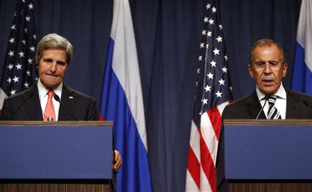 U.S. Secretary of State Kerry pauses while Russian FM Lavrov answers a question at a news conference in Geneva