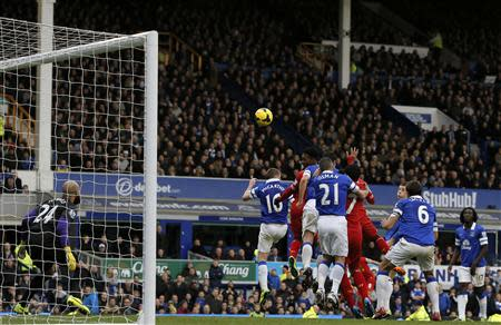 Liverpool's Daniel Sturridge (C) scores a goal against Everton during their English Premier League soccer match at Goodison Park in Liverpool, northern England November 23, 2013. REUTERS/Phil Noble