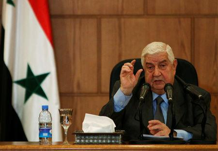 Syria's Foreign Minister Walid al-Moualem speaks during a news conference in Damascus
