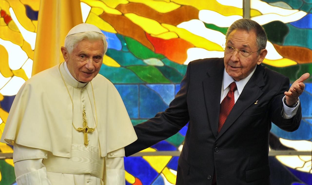 Cuba's President Raul Castro, right, and Pope Benedict XVI meet in Havana, Cuba, Tuesday, March 27, 2012. The meeting took place behind closed doors on the pontiff's second day on the island. (AP Photo/Adalberto Roque, Pool)