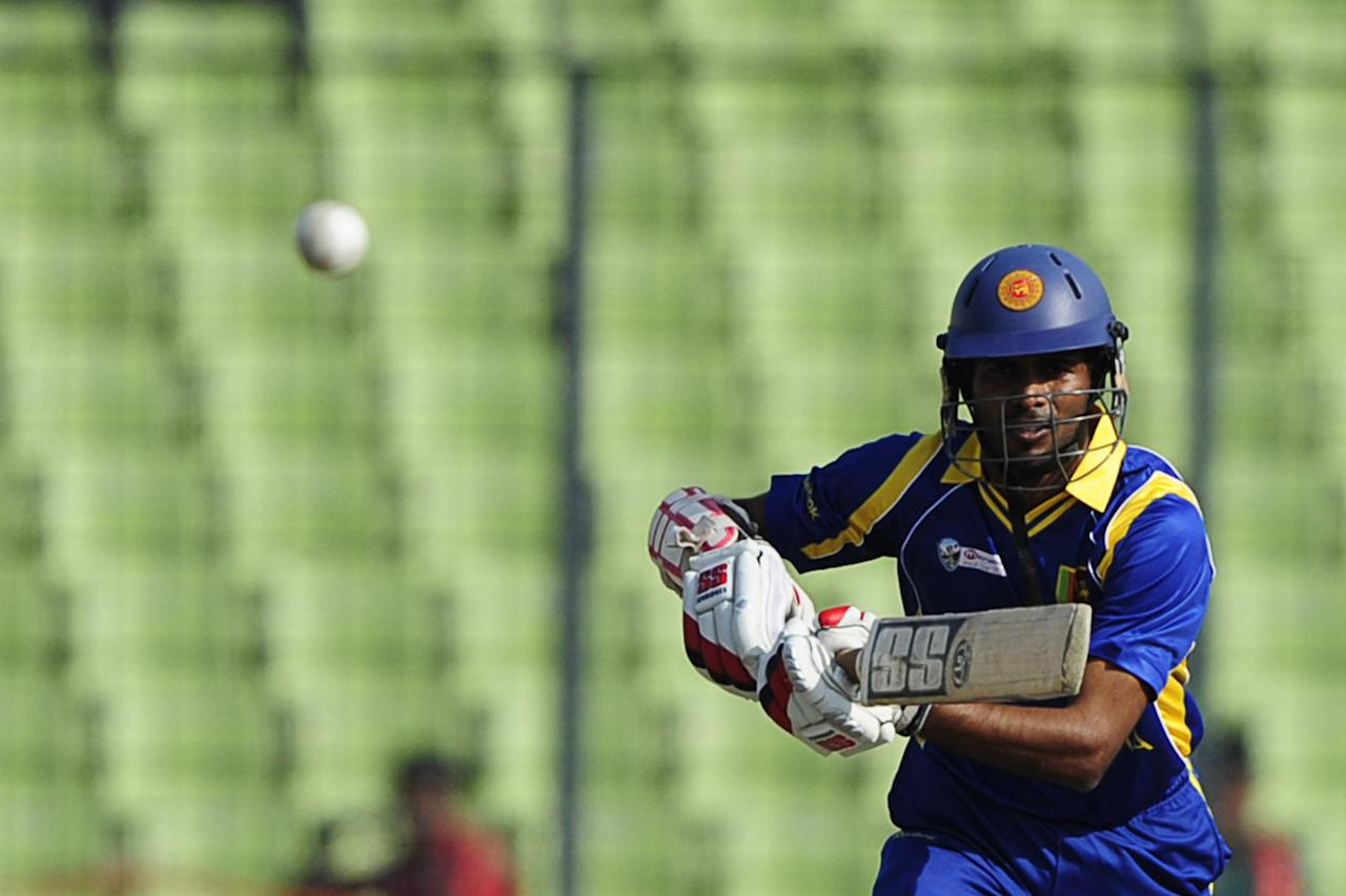 Sri Lankan batsman Upul Tharanga plays a shot during the one day international (ODI) Asia Cup cricket match between Pakistan and Sri Lanka at the Sher-e-Bangla National Cricket Stadium in Dhaka on March 15, 2012. AFP PHOTO/Munir uz ZAMAN (Photo credit should read MUNIR UZ ZAMAN/AFP/Getty Images)