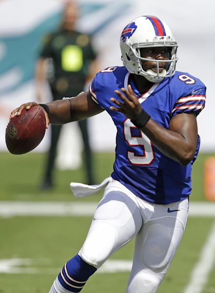 Buffalo Bills quarterback Thad Lewis (9) looks to pass during the first half of an NFL football game against the Miami Dolphins, Sunday, Oct. 20, 2013, in Miami Gardens, Fla. (AP Photo/Wilfredo Lee)