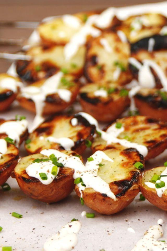 """<p>The slight bitterness from the char is brightened up with a heavy drizzling of ranch.</p><p>Get the recipe from <a href=""""https://www.delish.com/cooking/recipe-ideas/recipes/a53181/grilled-ranch-potatoes-recipe/"""" rel=""""nofollow noopener"""" target=""""_blank"""" data-ylk=""""slk:Delish"""" class=""""link rapid-noclick-resp"""">Delish</a>.</p>"""