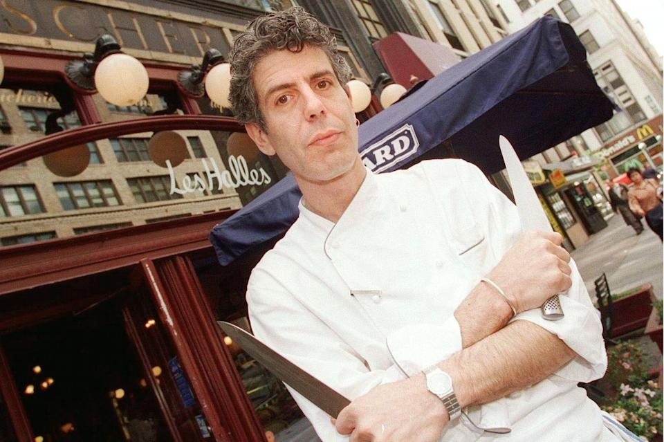 <p>Bourdain outside New York's Les Halles restaurant on May 15, 2000, two years after he became executive chef at the French bistro. In 2000, Bourdain's memoir, <em>Kitchen Confidential</em>, was published. It became a bestseller and launched him into the spotlight. </p>