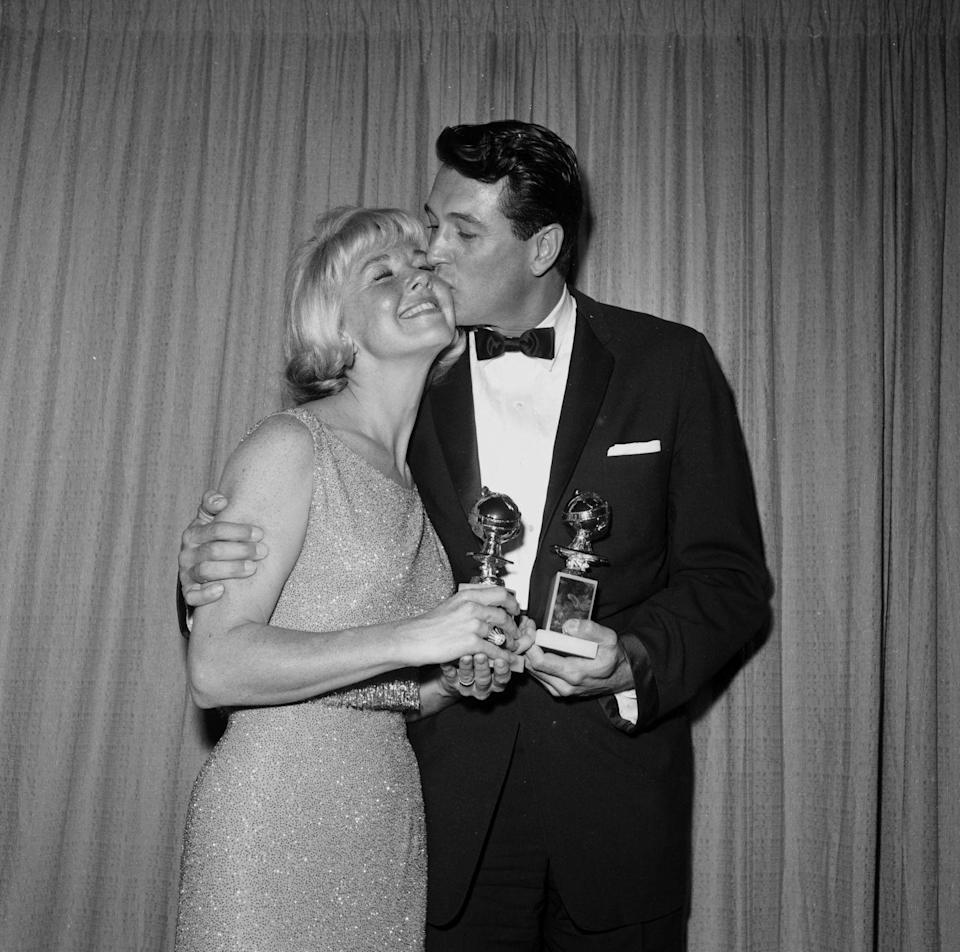 <p>Actor Rock Hudson and actress Doris Day pose with their newly appointed Golden Globe statues in 1962.</p>