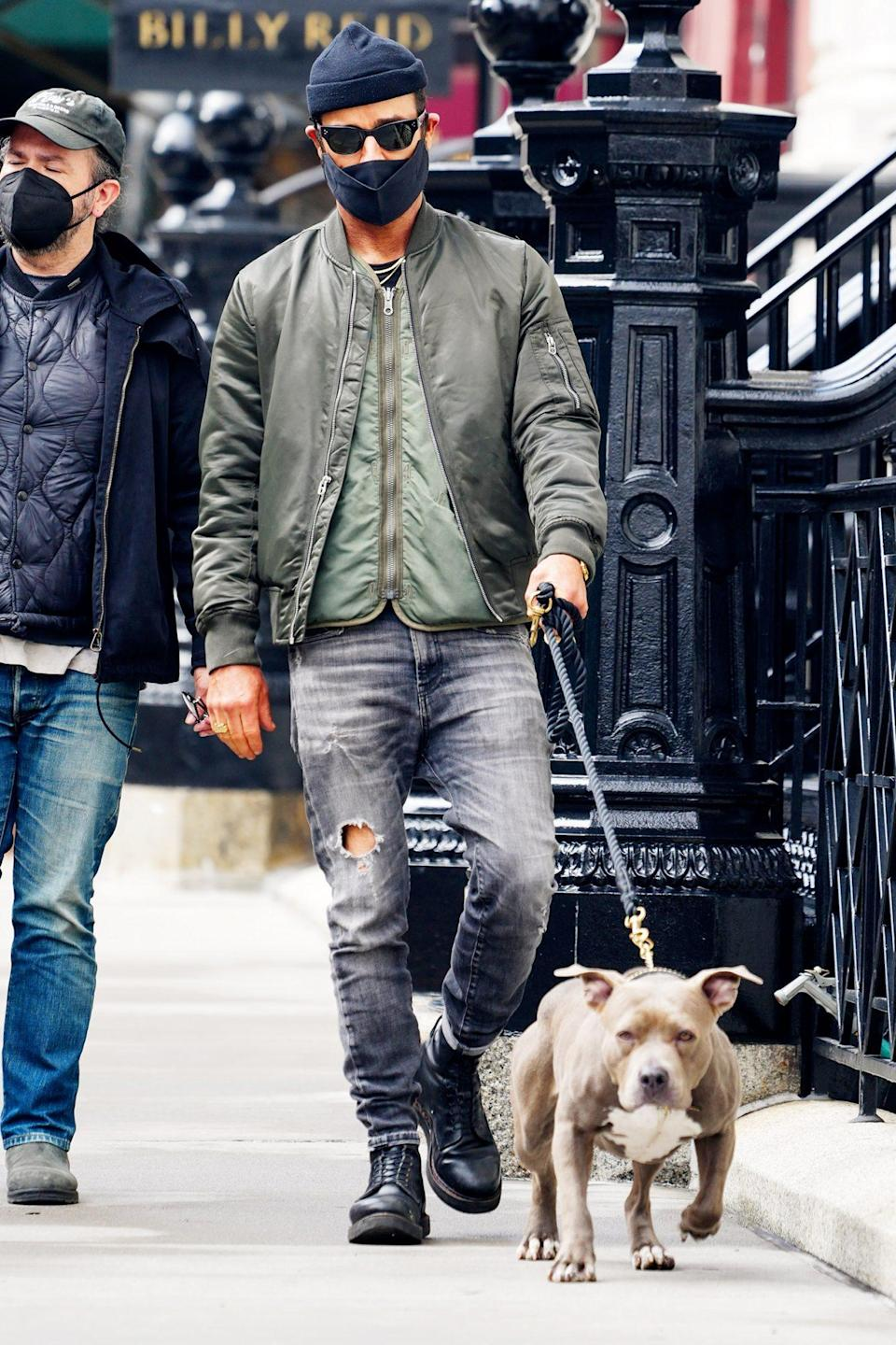 <p>Justin Theroux takes his dog Kuma for an afternoon stroll in N.Y.C. on Thursday.</p>