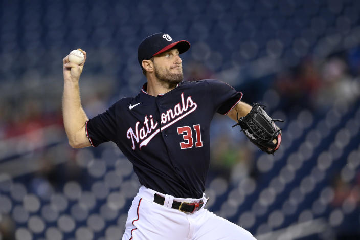 Washington Nationals starting pitcher Max Scherzer throws during the first inning of the team's baseball game against the San Francisco Giants, Friday, June 11, 2021, in Washington. (AP Photo/Nick Wass)