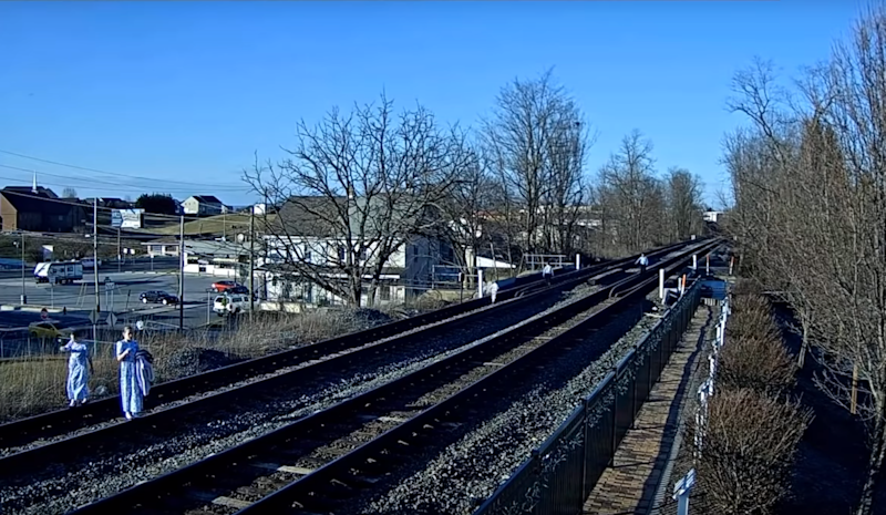 Family nearly hit by train while taking photos on rail tracks: Virtual Railfan