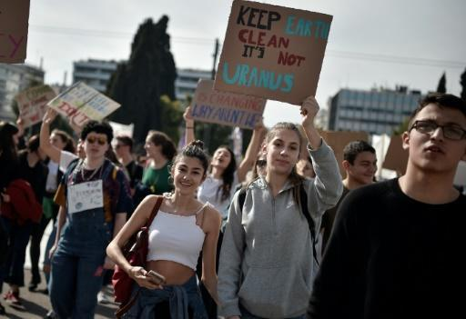 The weird memes and the inappropriate jokes are a way for younger people to express their frustration with the world at large, such as these students (pictured March 2019) in front of the Greek parliament in Athens protesting against climate change