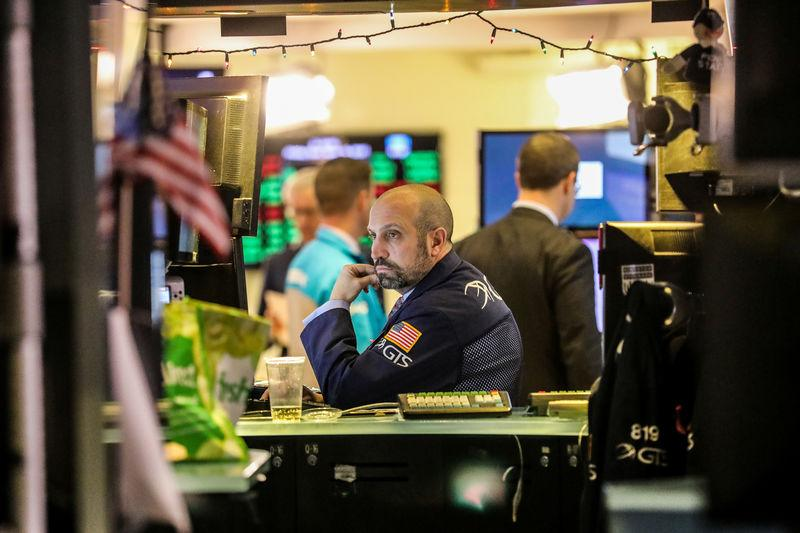 Wall Street rises, limps across the finish line of turbulent year