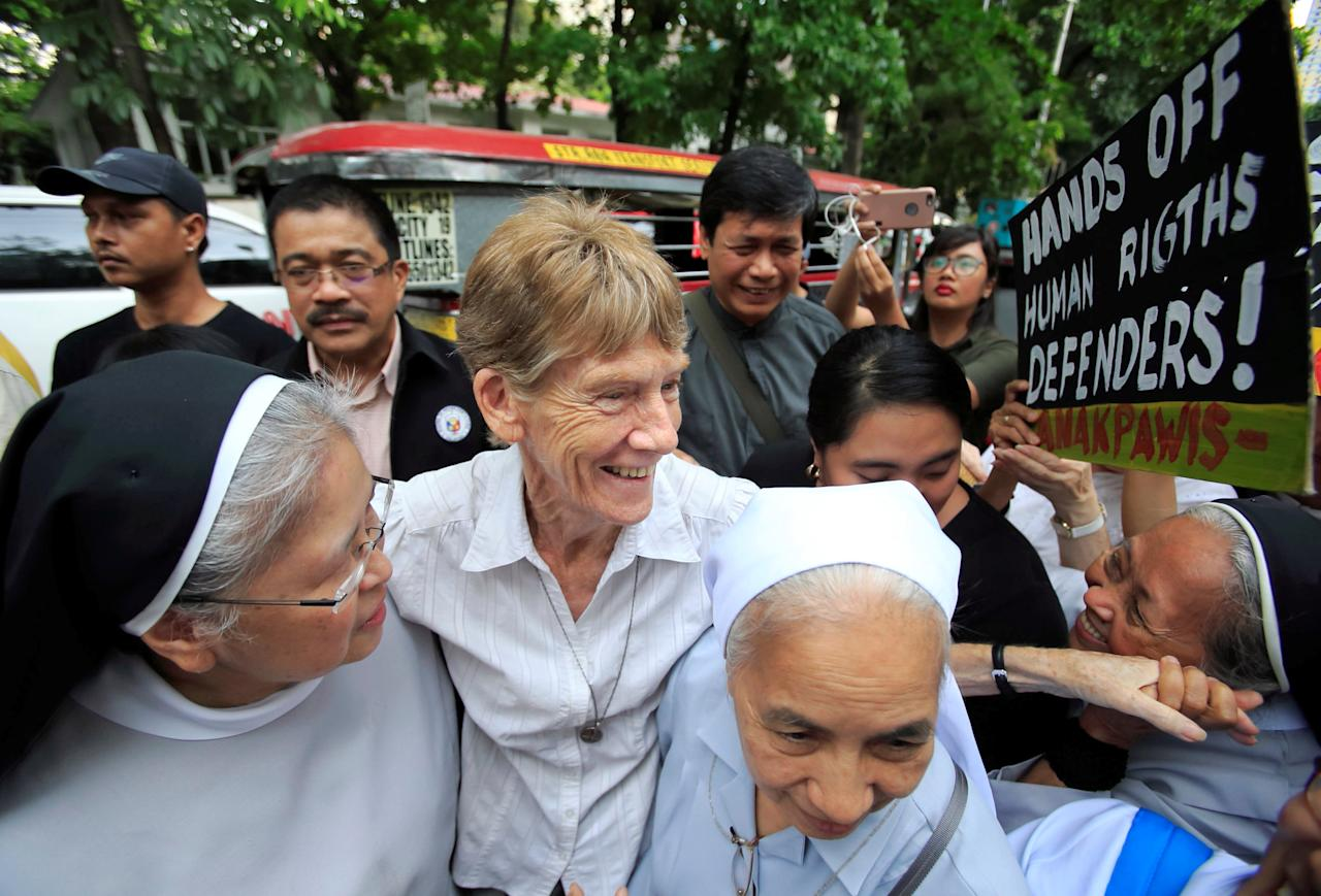 Australian missionary Patricia Fox (C) is escorted by her colleagues before filing a petition calling for the review of her deportation case at the Department of Justice, after the immigration bureau voided her visa following complaints from Philippine President Rodrigo Duterte about her participation in protest rallies, in Padre Faura, metro Manila, Philippines May 25, 2018. REUTERS/Romeo Ranoco