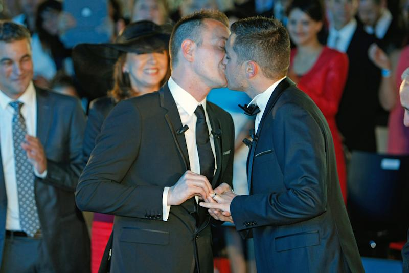 Vincent Autin, left, and Bruno Boileau, exchange a kiss during their civil wedding at Montpelier City Hall, Wednesday May 29, 2013. Bruno Boileau, 30, from Paris and Vincent Autin, 40, are the first same-sex couple to marry in France, since French government voted a new law legalizing same-sex marriage.(AP Photo/Claude Paris)