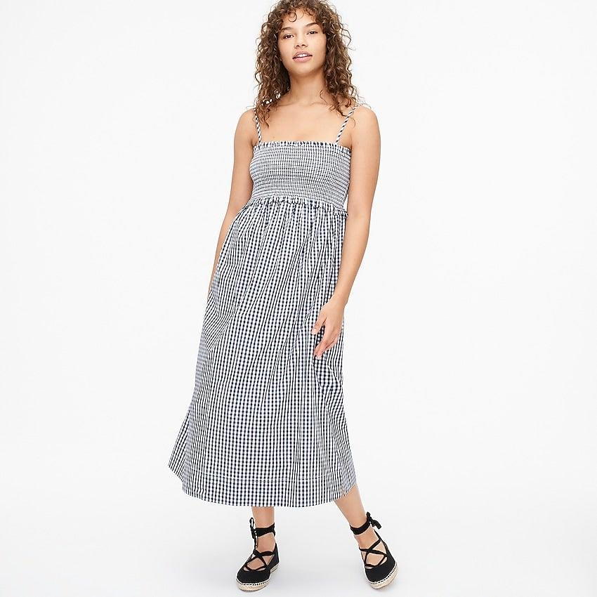 """<br><br><strong>J.Crew</strong> Smocked cotton poplin dress in gingham, $, available at <a href=""""https://go.skimresources.com/?id=30283X879131&url=https%3A%2F%2Fwww.jcrew.com%2Fp%2Fwomens%2Fcategories%2Fclothing%2Fdresses-and-jumpsuits%2Fsmocked-cotton-poplin-dress-in-gingham%2FAY868%3Fdisplay%3Dsale%26fit%3DClassic%26isFromSale%3Dtrue%26color_name%3Dwhite-navy%26colorProductCode%3DAY868"""" rel=""""nofollow noopener"""" target=""""_blank"""" data-ylk=""""slk:J. Crew"""" class=""""link rapid-noclick-resp"""">J. Crew</a>"""