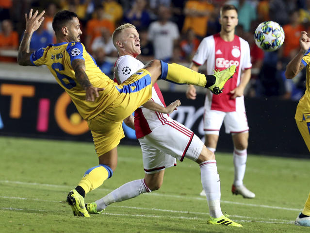 Ajax's Donny van de Beek, right, challenges for the ball with APOEL's Savvas Gentsoglou during the Champions League qualifying play-off first leg soccer match between APOEL Nicosia and AFC Ajax at GSP stadium in Nicosia, Cyprus, Tuesday, Aug. 20, 2019.(AP Photo/Philippos Christou)