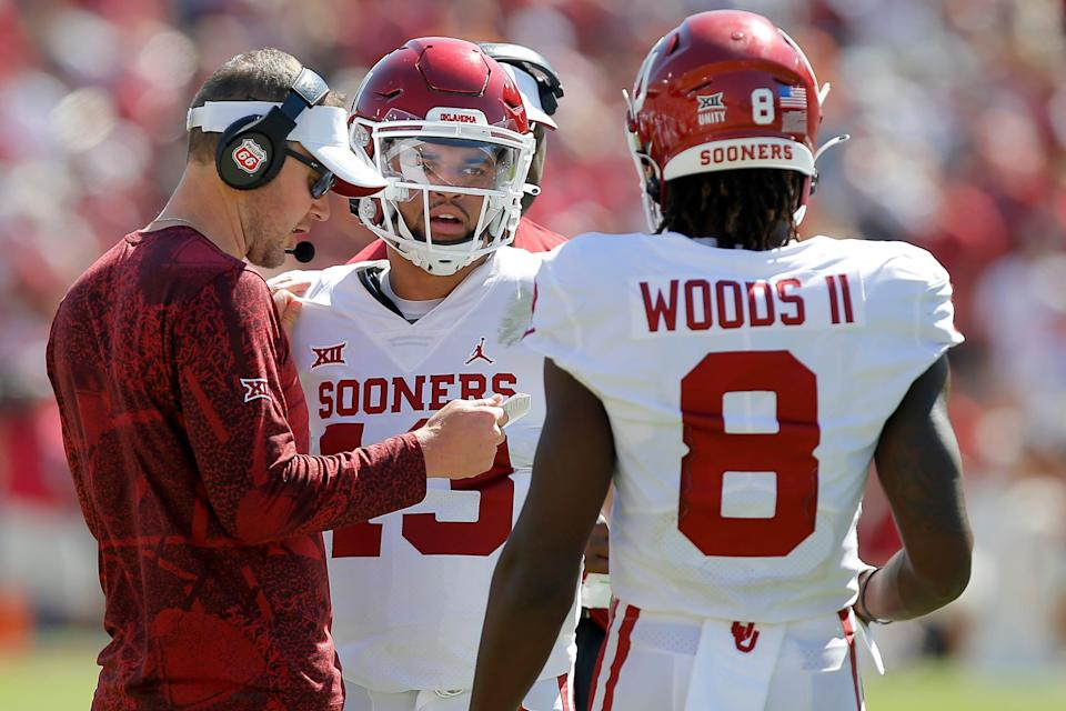 OU coach Lincoln Riley talks with quarterback Caleb Williams (13) during the Sooners' 55-48 win against Texas at the Cotton Bowl in Dallas on Saturday.