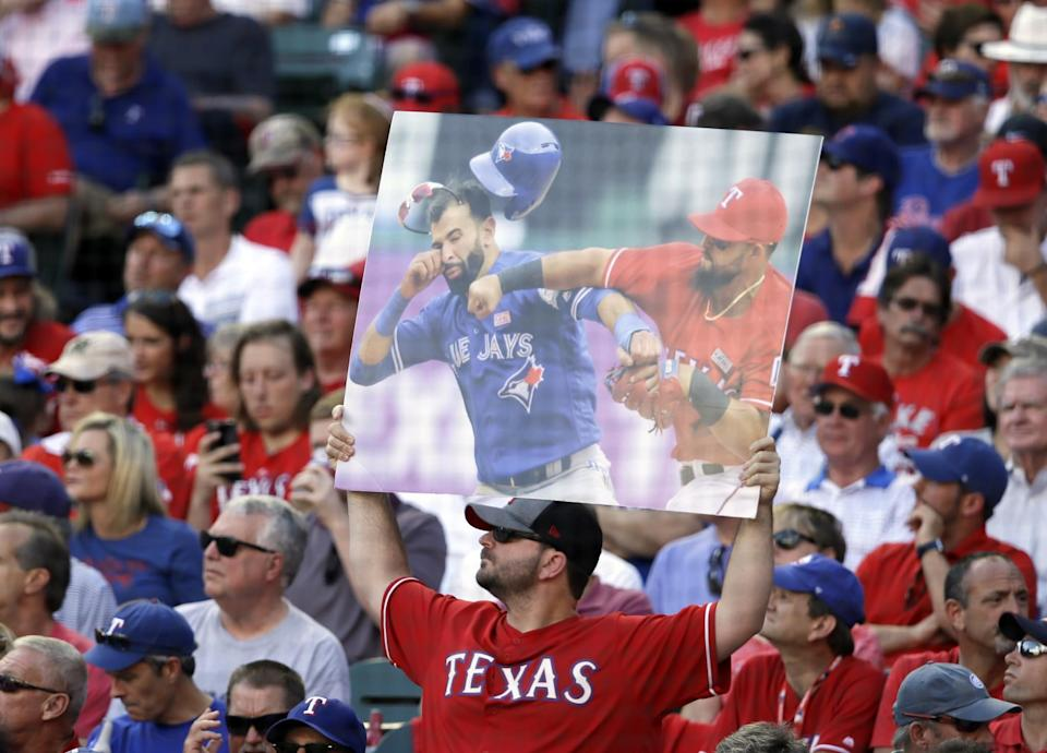 Rangers fans came ready to remind everyone about The Punch. (AP)