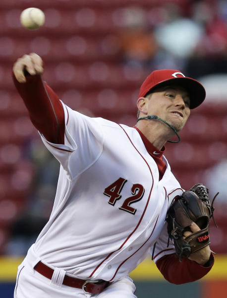 Cincinnati Reds starting pitcher Mike Leake throws to a Pittsburgh Pirates batter in the first inning of a baseball game, Tuesday, April 15, 2014, in Cincinnati. (AP Photo/Al Behrman)