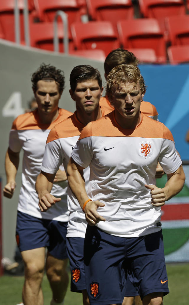 Netherlands' Dirk Kuyt runs laps with teammates during a training session at the Estadio Nacional in Brasilia, Brazil, Friday, July 11, 2014. The Netherlands will face Brazil in the World Cup third-place match Saturday. (AP Photo/Andre Penner)