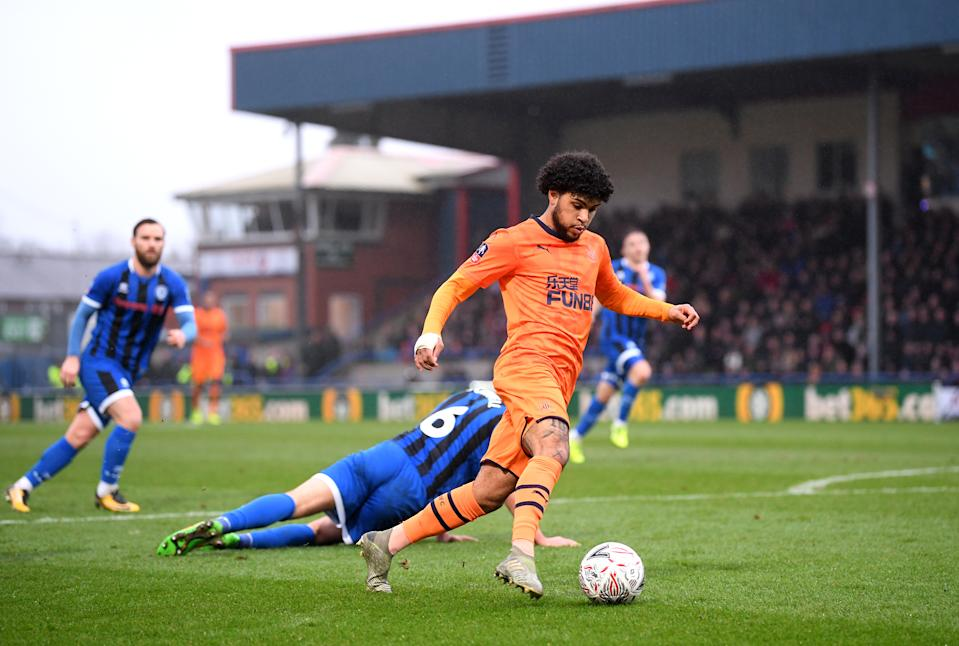 Deandre Yedlin of Newcastle United runs past Eoghan O'Connell of Rochdale. (Credit: Getty Images)