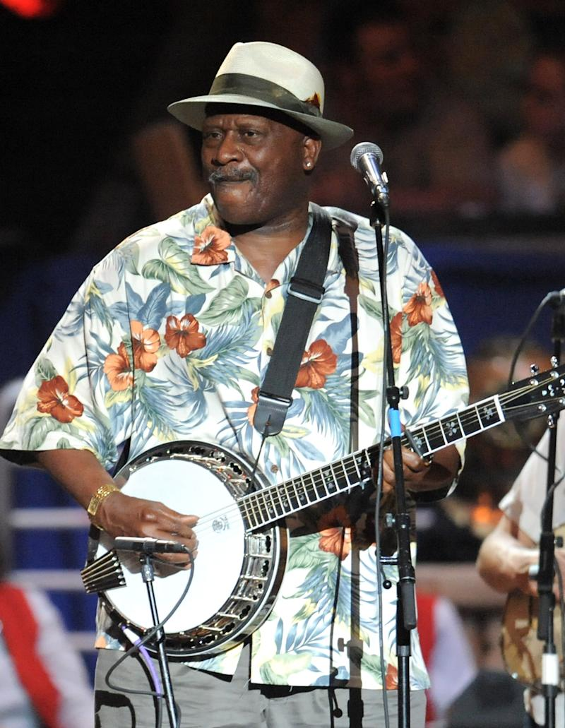 FILE - In this May 3, 2009, file photo, Taj Mahal performs at a benefit concert celebrating Pete Seeger's 90th birthday at Madison Square Garden in New York. The artist known as Taj Mahal, who has played an average of 125 concerts a year since 1968, turns 70 somewhere on the road between Kansas and Colorado in May. But his next stop is Alaska, a place he first visited sometime in the 1970s and a place he has returned routinely since. Two things keep him coming back: the fish and the widespread appreciation for a musician who travels this far north and stops somewhere besides Anchorage. (AP Photo/Evan Agostini, File)