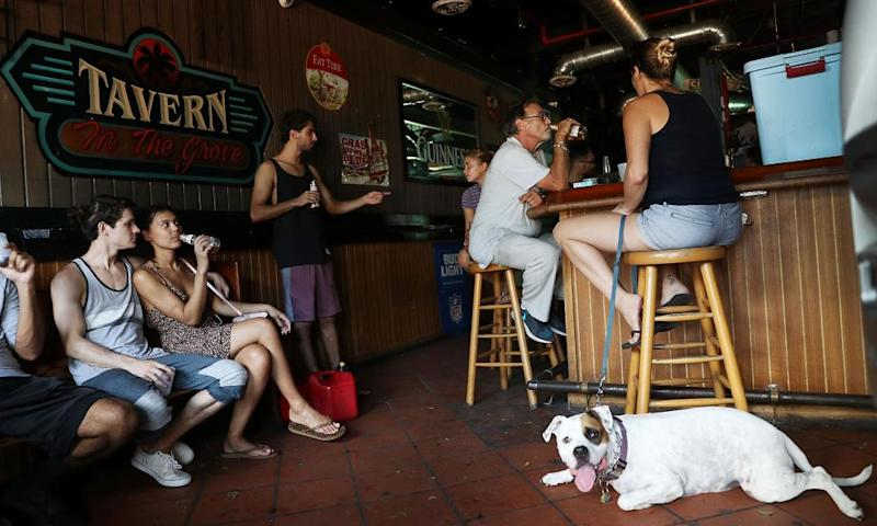 Patrons drink at a bar in Miami, Florida, after hurricane Irma passed through. Florida's hospitality and tourism industry employs 1.4 million people.