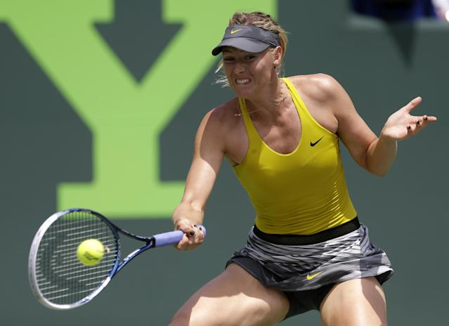 Maria Sharapova, of Russia, returns to Serena Williams at the Sony Open Tennis tournament in Key Biscayne, Fla., Thursday, March 27, 2014. (AP Photo/Alan Diaz)